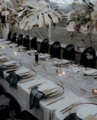 Dove Chiffon table runner on Whisper Weave overlays with Emerald Velvet napkins
