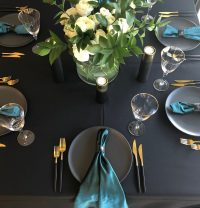 Emerald velvet napkin on Black Weave linen hire