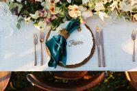 Emerald velvet napkins on Whisper Weave overlays